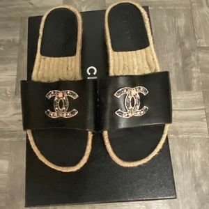 Chanel black leather mosaic logo mules
